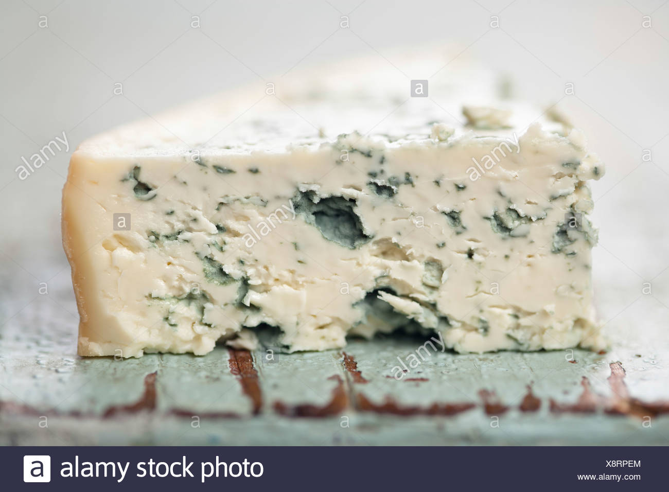 Piece of soft blue cheese - Stock Image