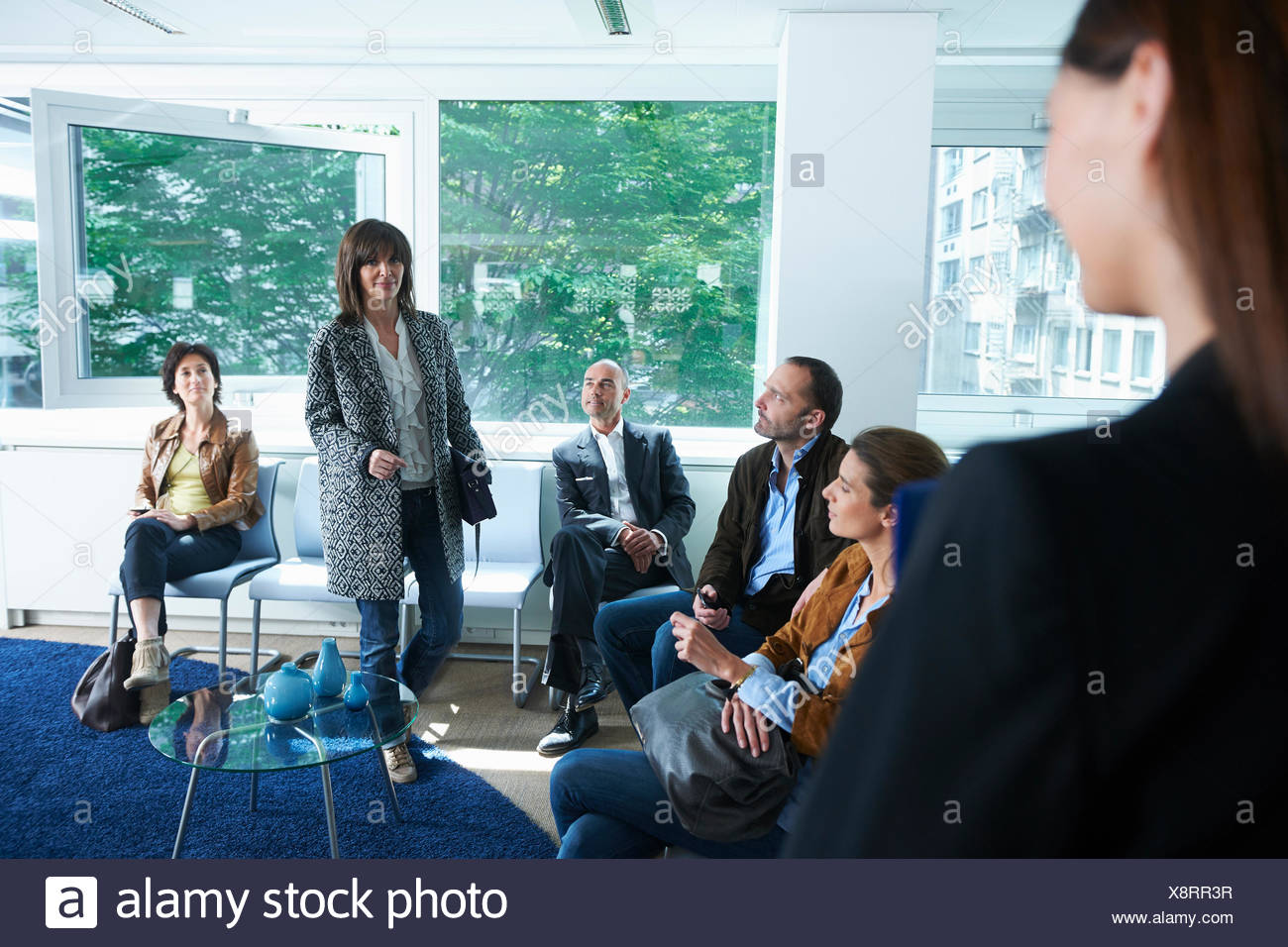 Woman being called for interview - Stock Image