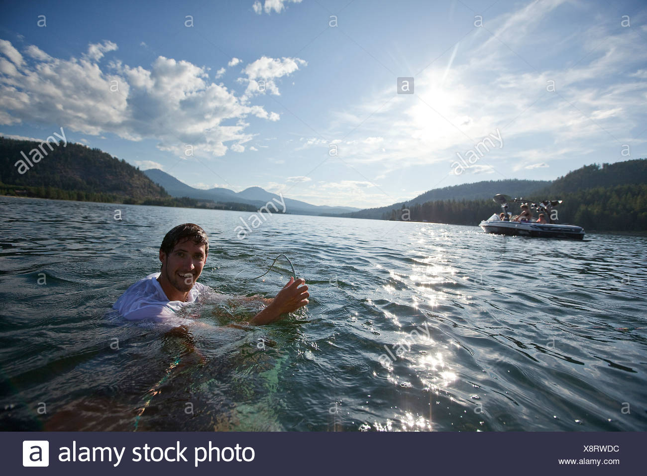 Male wakeboarding in Idaho. - Stock Image
