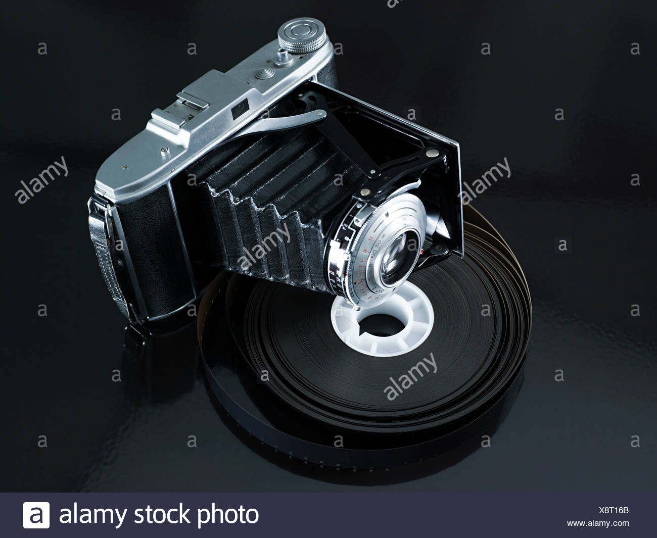 Camera and roll of film - Stock Image