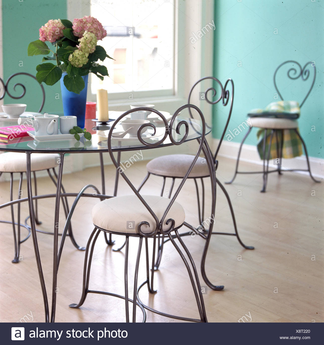 Tavolo Rotondo Vetro Design.Round Metal And Glass Dining Table And Chairs Stock Photo