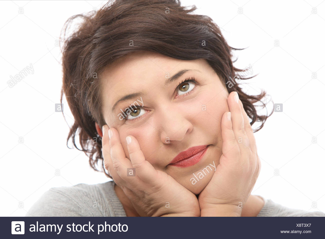 Woman daydreaming and looking to heaven - Stock Image