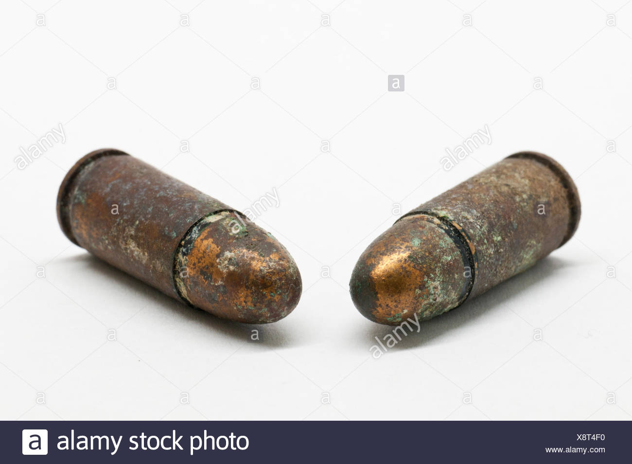 Close-Up Of Bullets Over White Background - Stock Image
