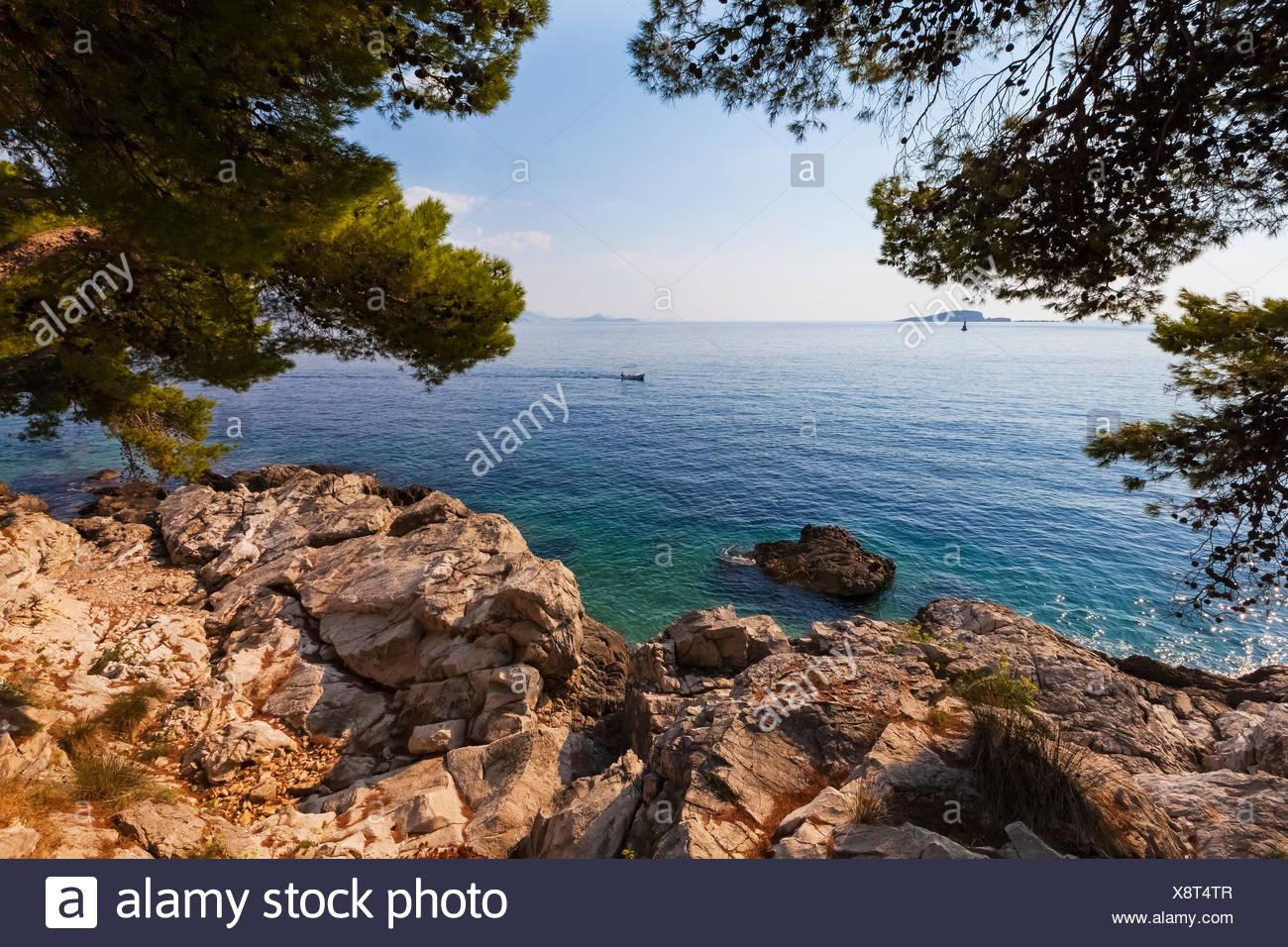 View from the rocky shoreline of Cavtat; Cavtat, Croatia - Stock Image