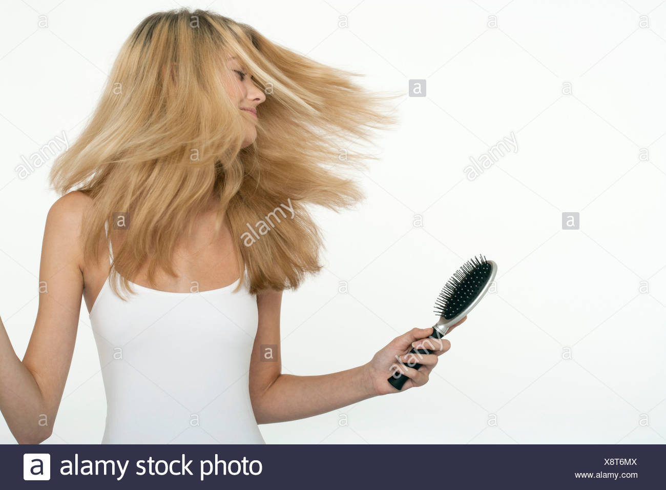 Teen girl tossing her hair - Stock Image