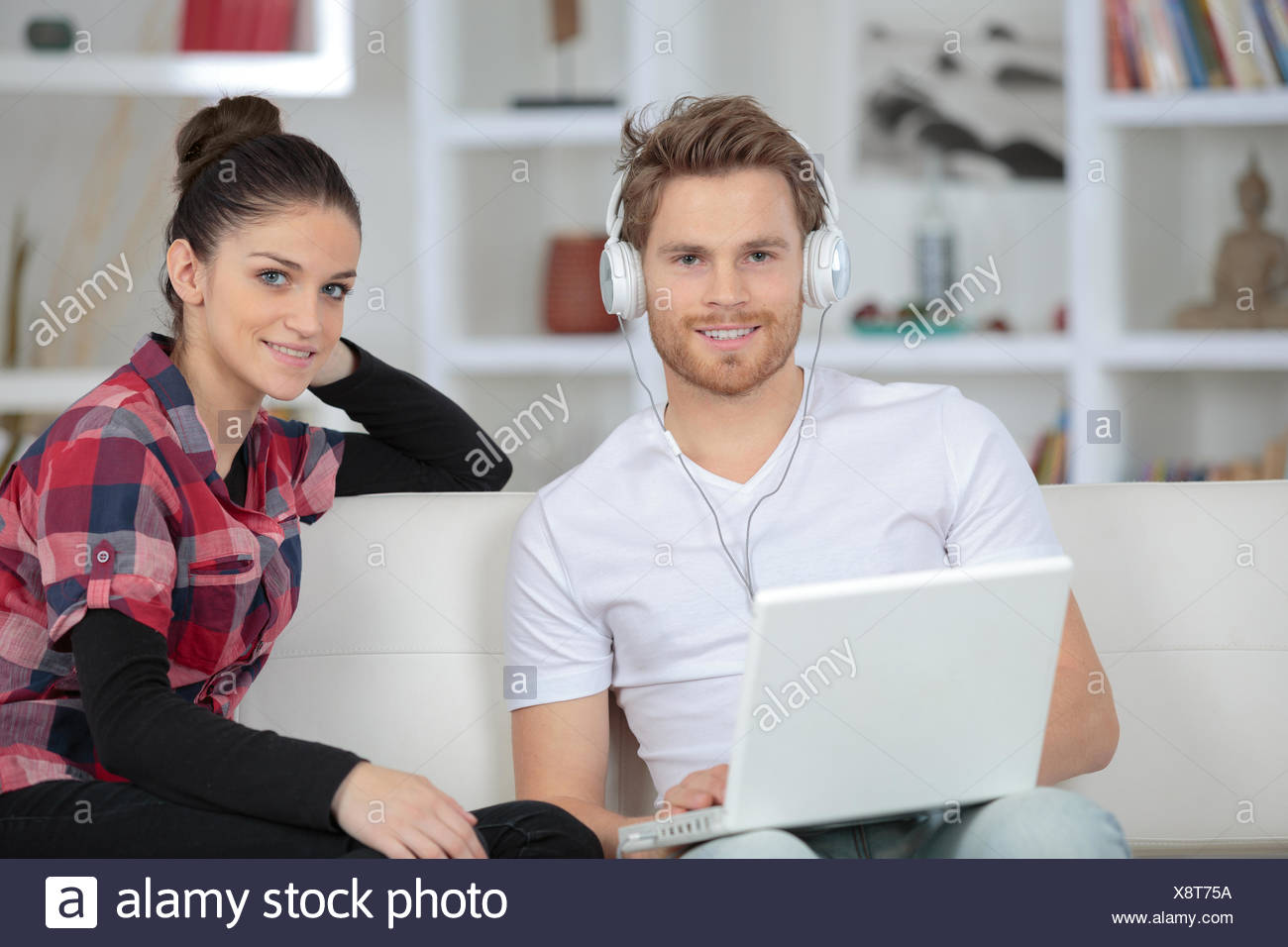 young couple shopping online at home on laptop stock photo rh alamy com online at home gigs online at home business
