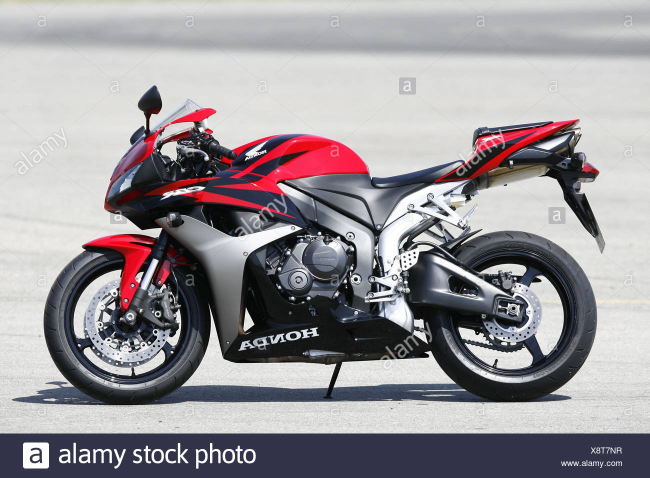 Red Honda Motorcycle Stock Photos 50cc Sport Bike Cbr Standard On The Right Image