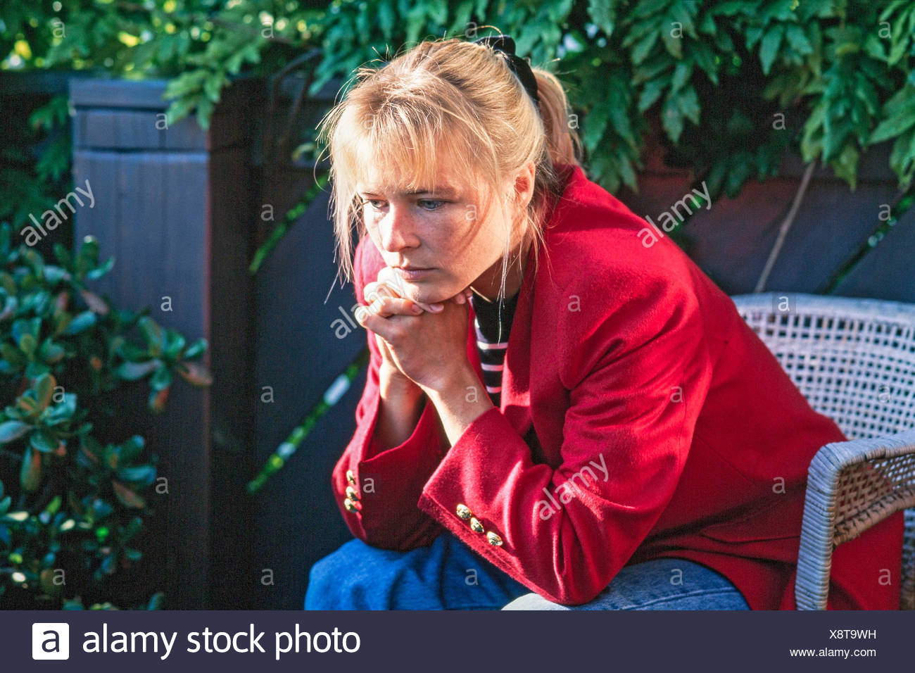 Young woman at depressive expression - Stock Image