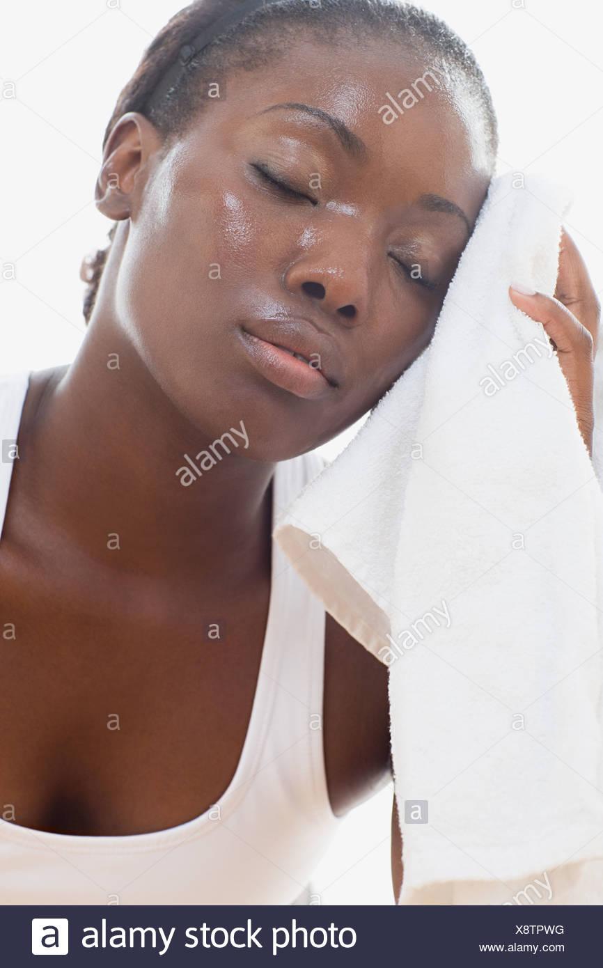 Female athlete sweating - Stock Image