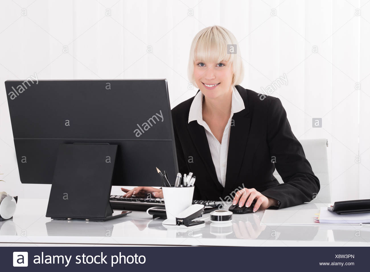 Businesswoman Working On Computer - Stock Image