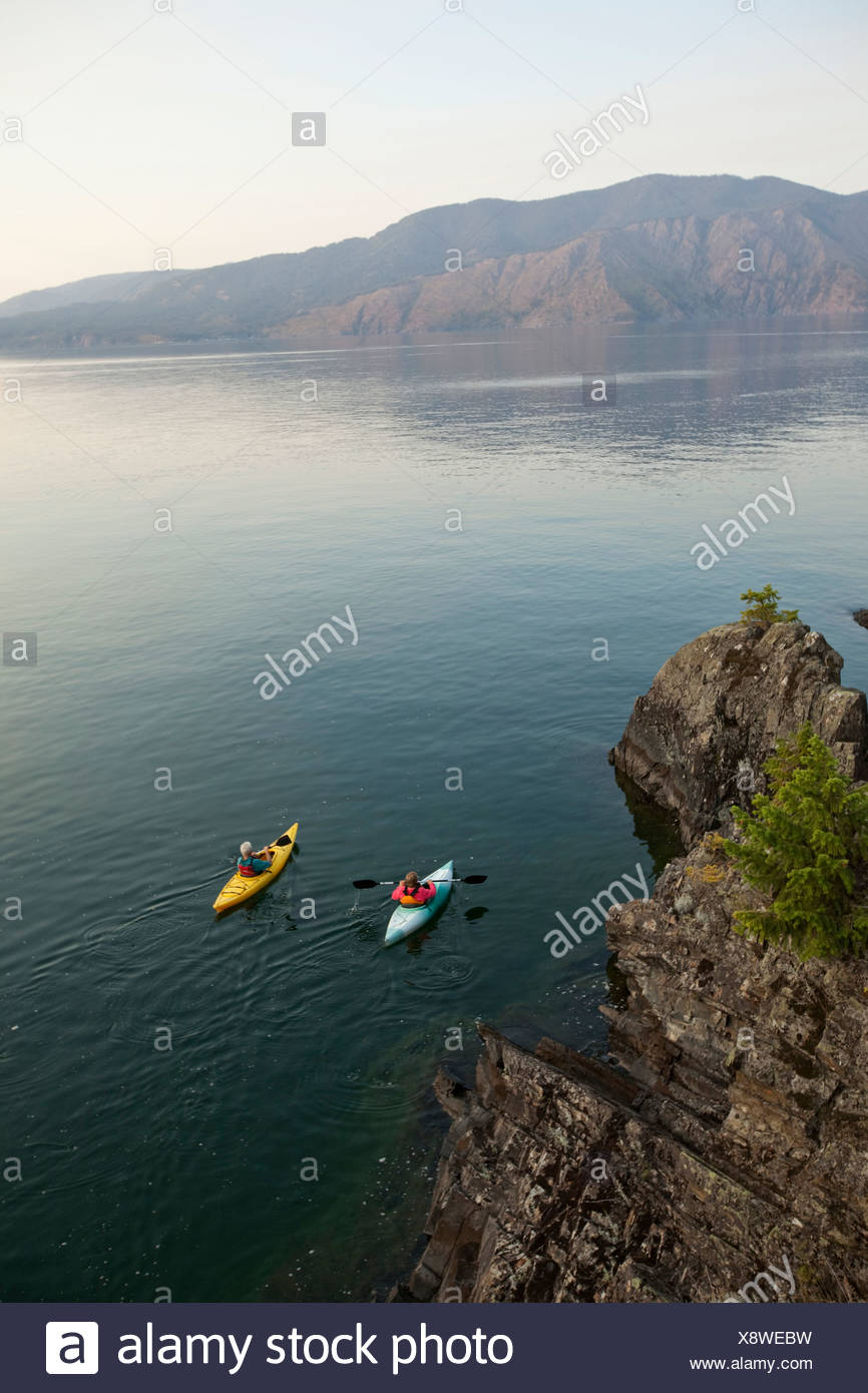 Retired couple kayak on a beautiful summer evening in Idaho. - Stock Image