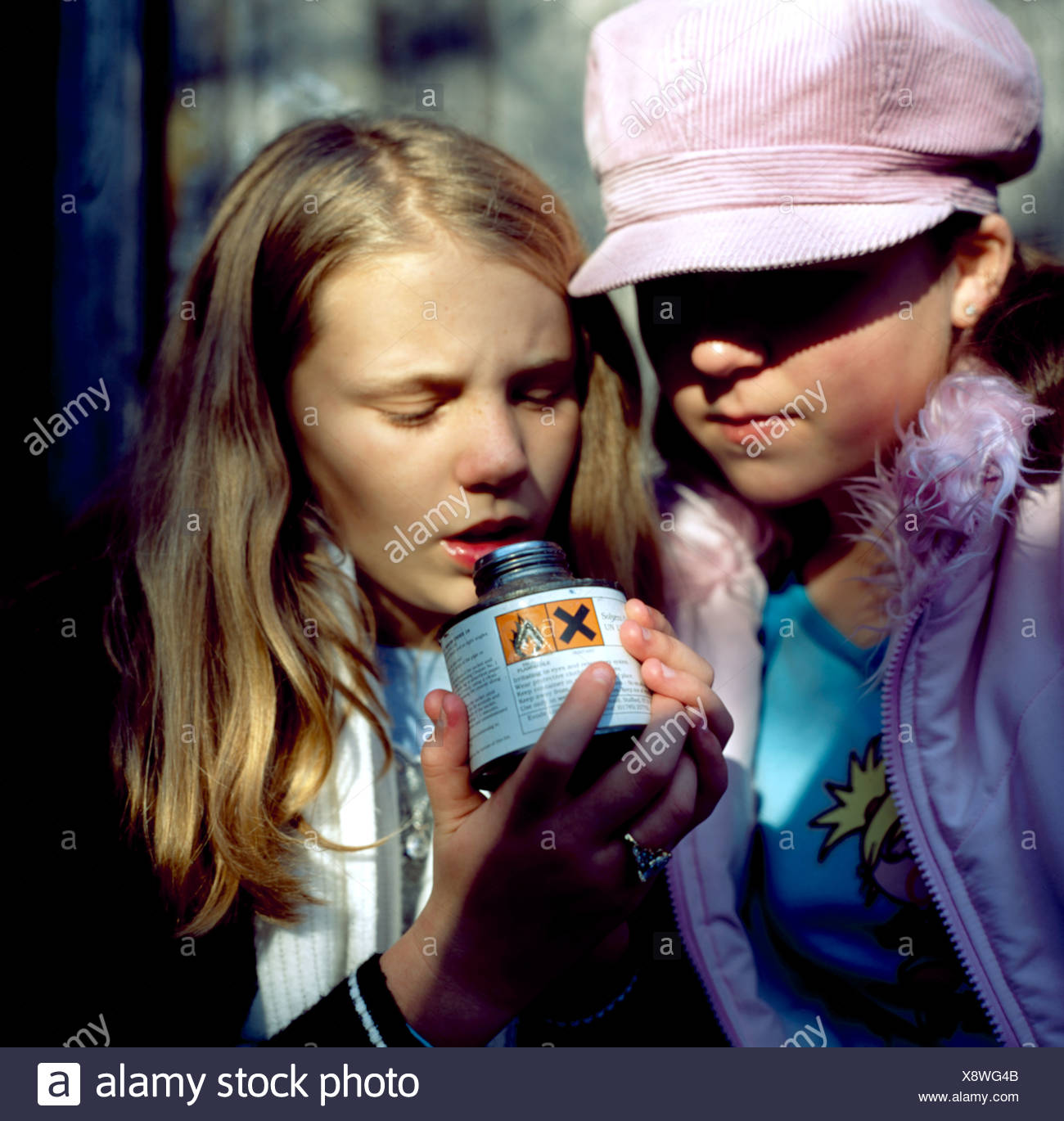 solvent-abuse-two-girls-sniffing-can-of-