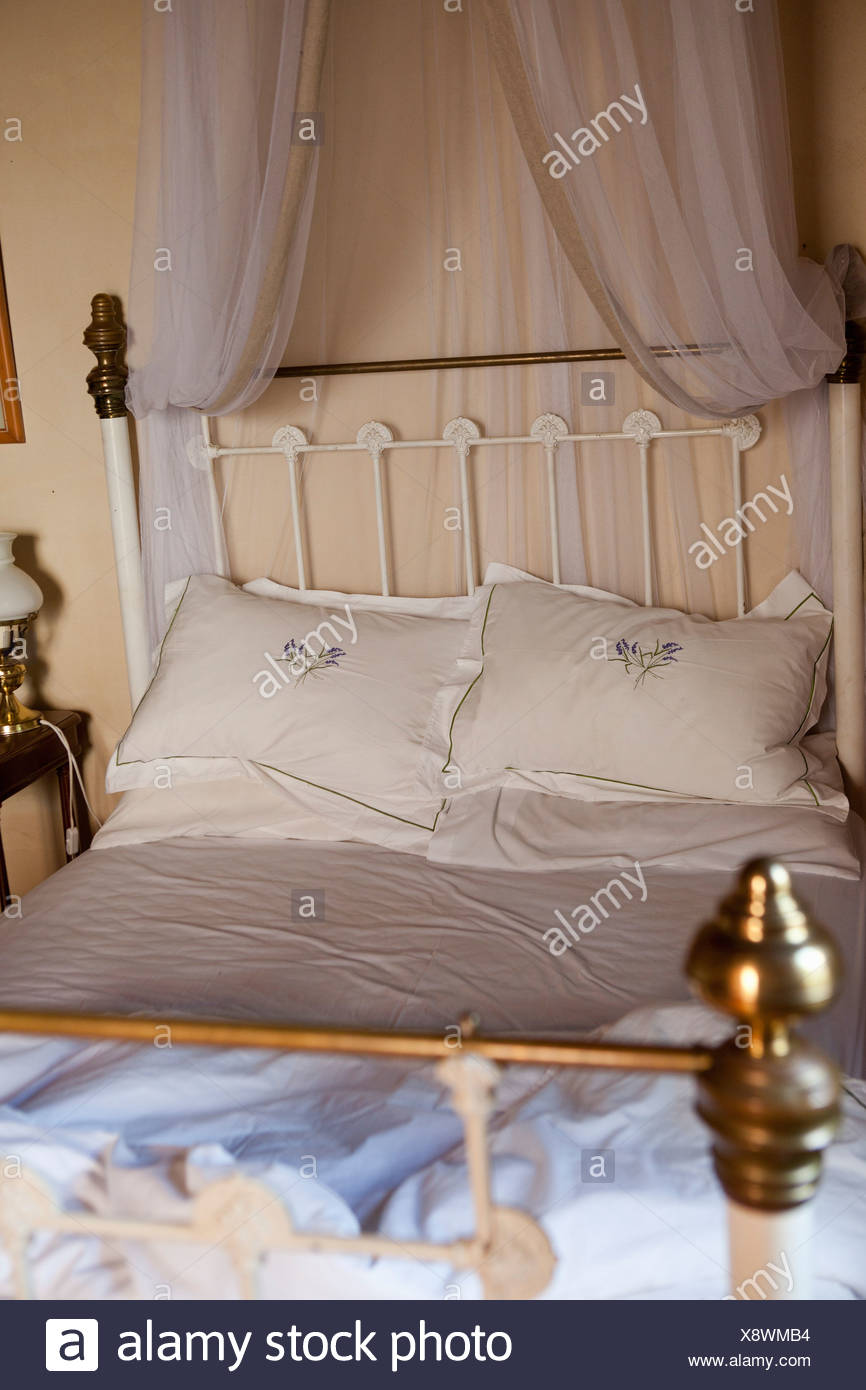 Old Fashioned Bed With Curtains   Stock Image