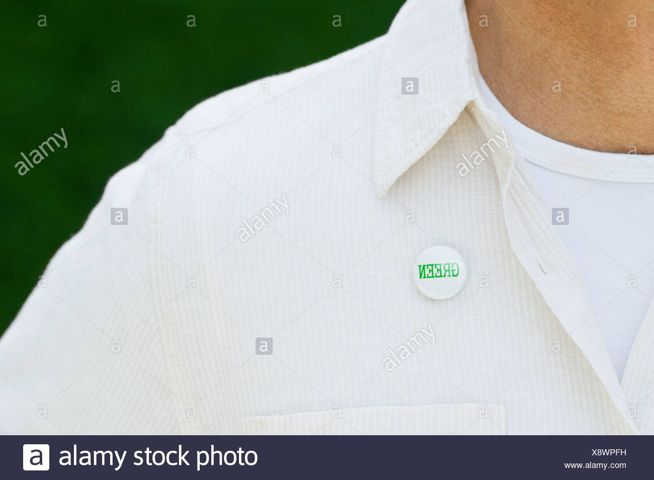 Eco-friendly button on man's shirt - Stock Image