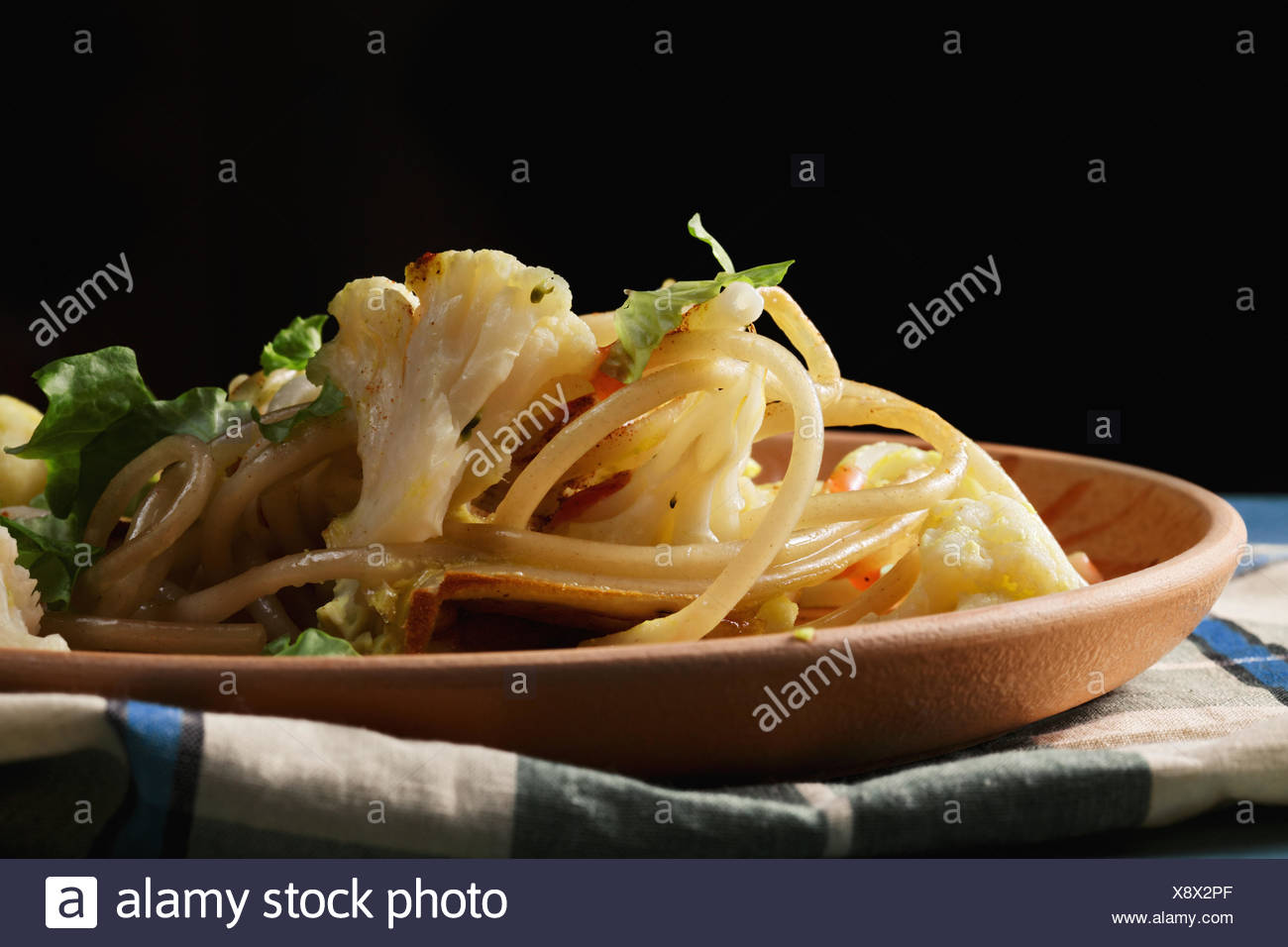 Pasta with cauliflower in darkness - Stock Image