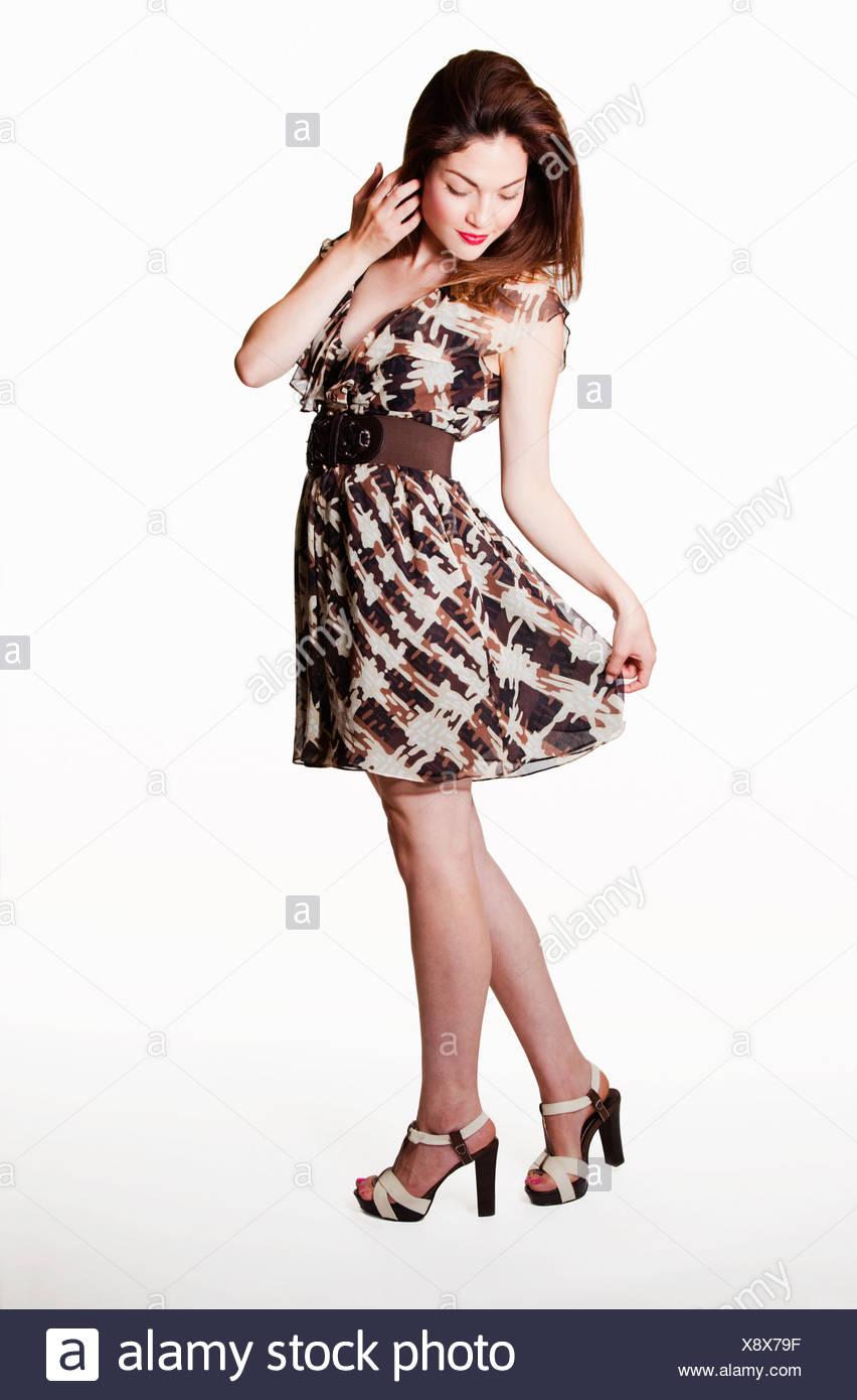 4788ac896b69f USA, California, Fairfax, Woman wearing skirt, against white background -  Stock Image