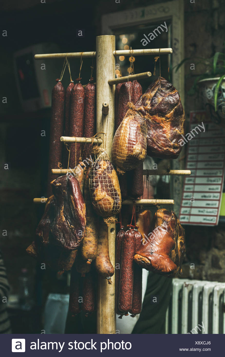 Variety of traditional Hungarian smoked meat and sausages at a  farmers market. - Stock Image