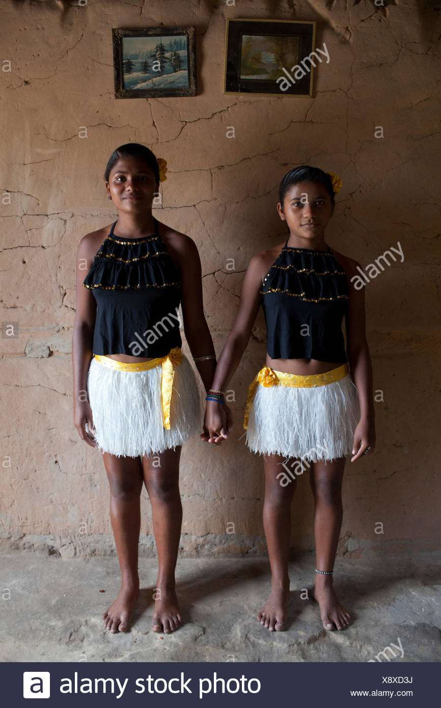 Sisters dress up in outfits for the upcoming Bumba-Meu-Boi festival. - Stock Image