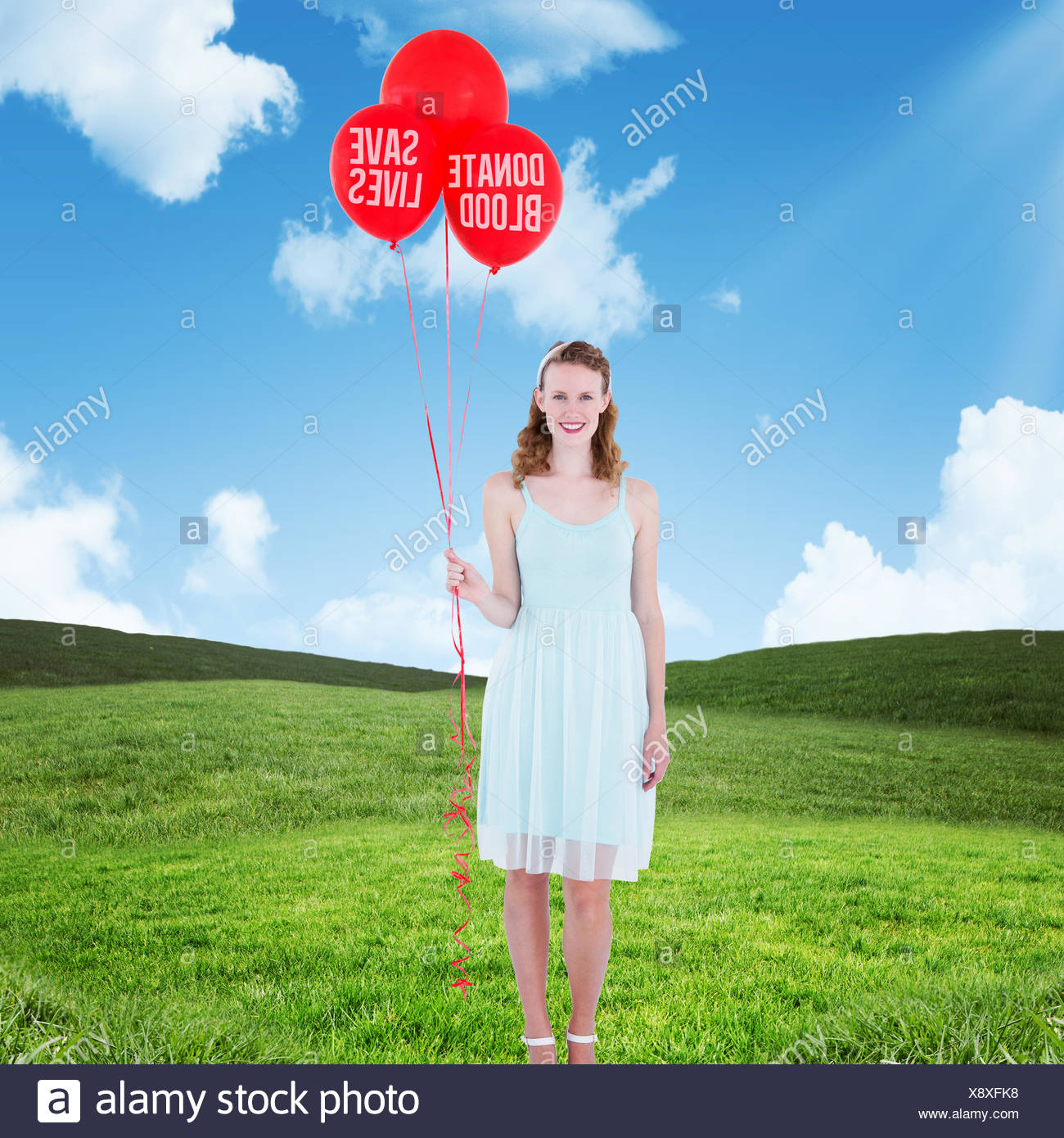 Composite image of happy hipster woman holding balloons - Stock Image