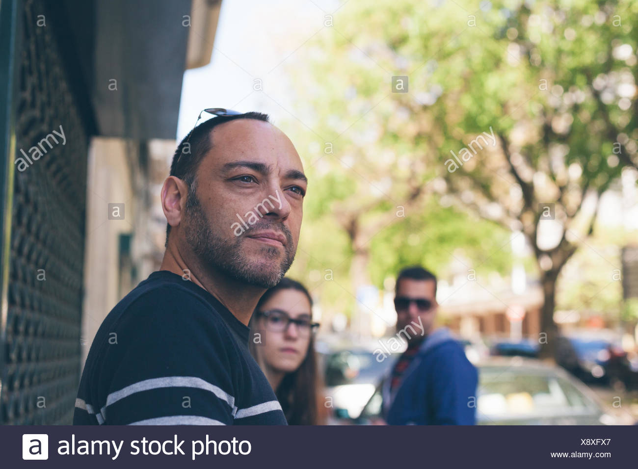 Mid Adult Man Looking Away On Footpath - Stock Image