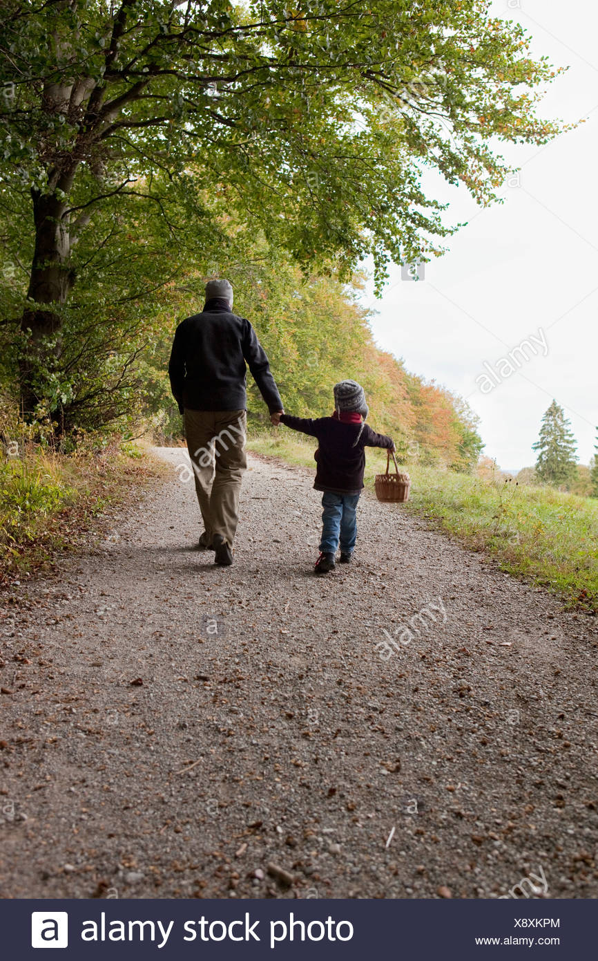 Father and son going for a walk - Stock Image