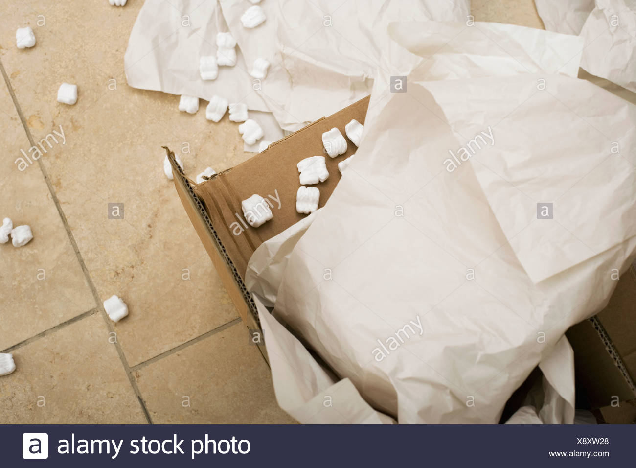 Paper and packing foam in open cardboard box close up Stock Photo