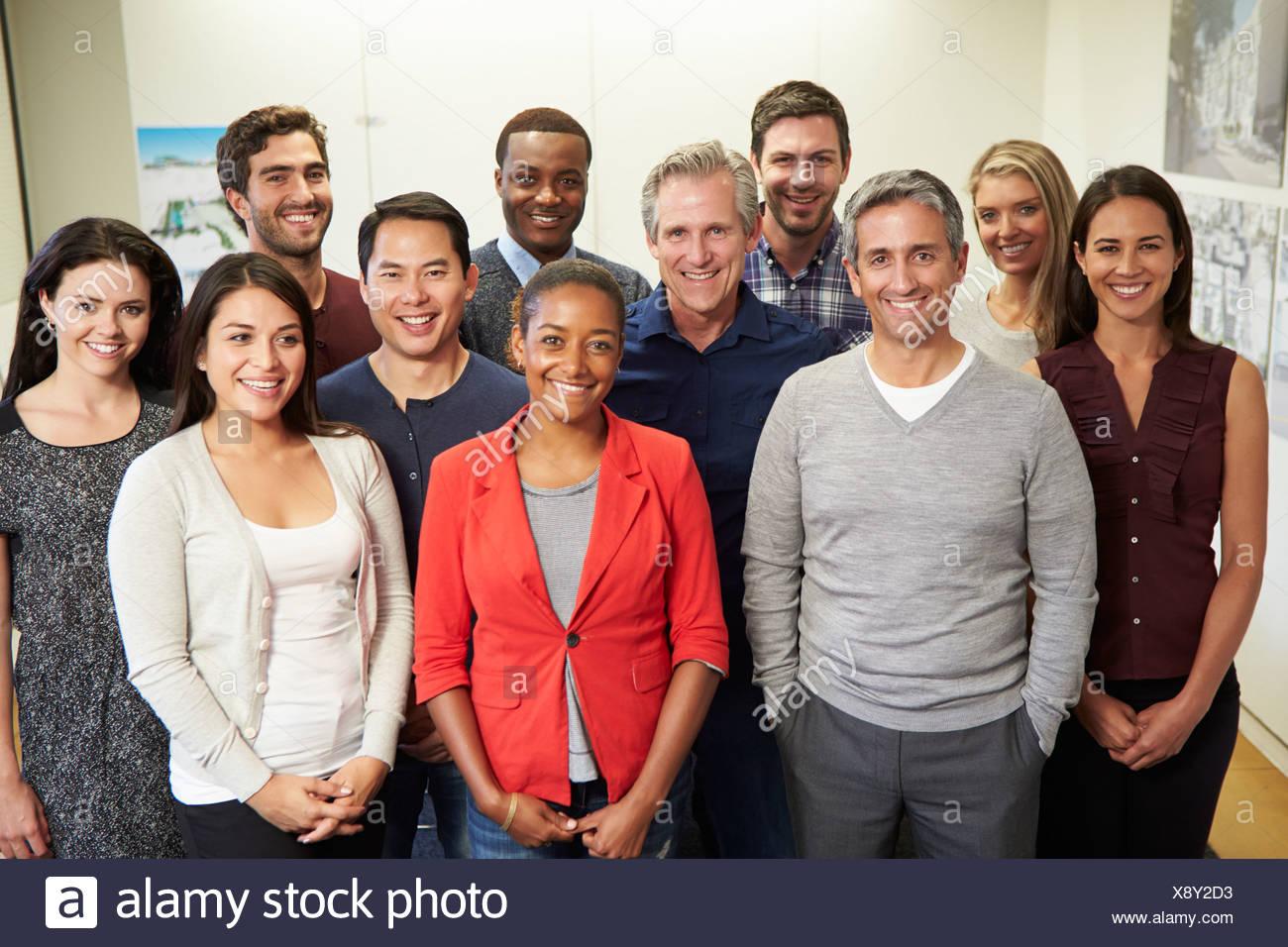 Portrait Of Staff In Modern Multi-Ethnic Office - Stock Image