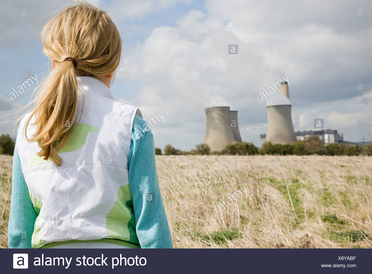 Girl by power station - Stock Image