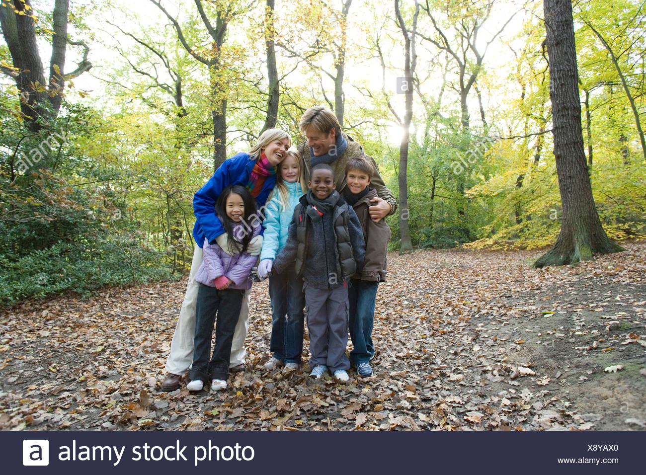 Parents and children in a wood in autumn. Stock Photo