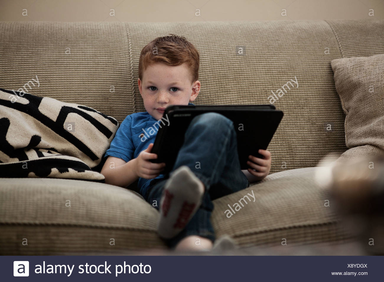 Boy with digital tablet - Stock Image