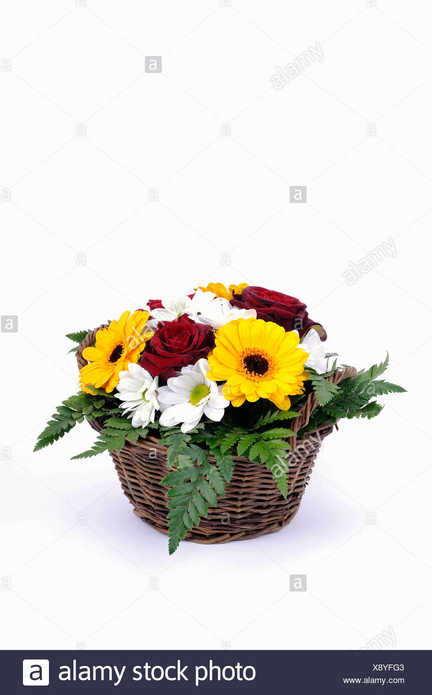 Bouquet of roses, daisies, gerbera, ferns, arranged in a basket Stock Photo