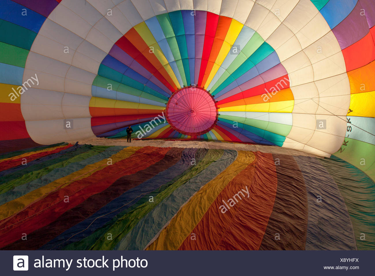 Brightly coloured hot air balloon from the inside, about to be filled with air before take-off, Sport Stock Photo
