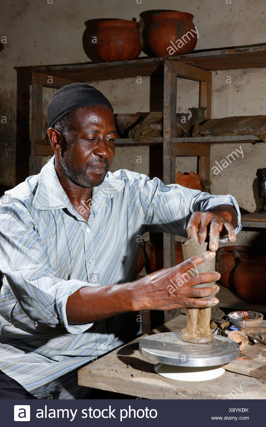 Man with clay figure, production of pottery, Bamessing, Cameroon, Africa - Stock Image