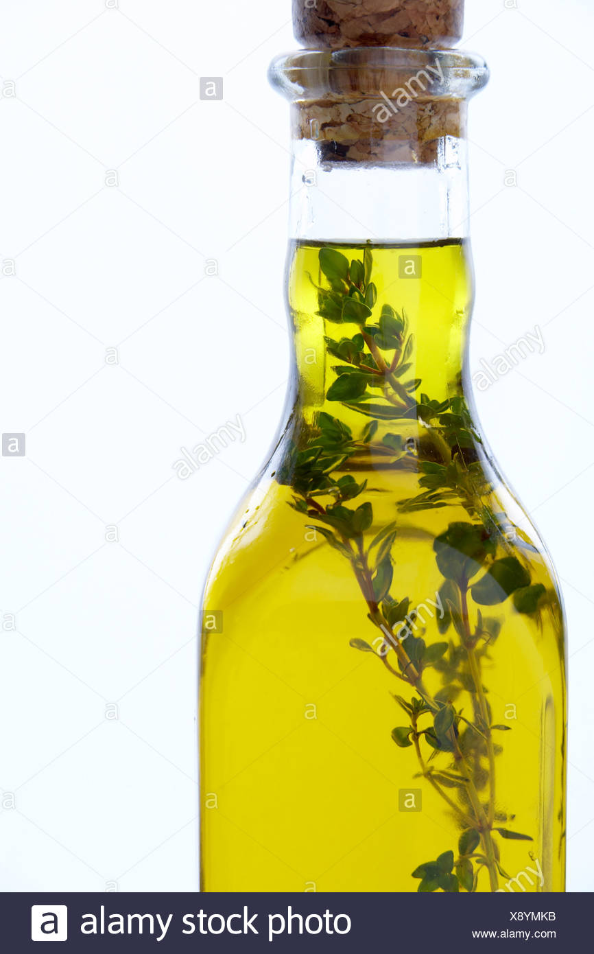 Bottle Of Olive Oil With Herbs - Stock Image