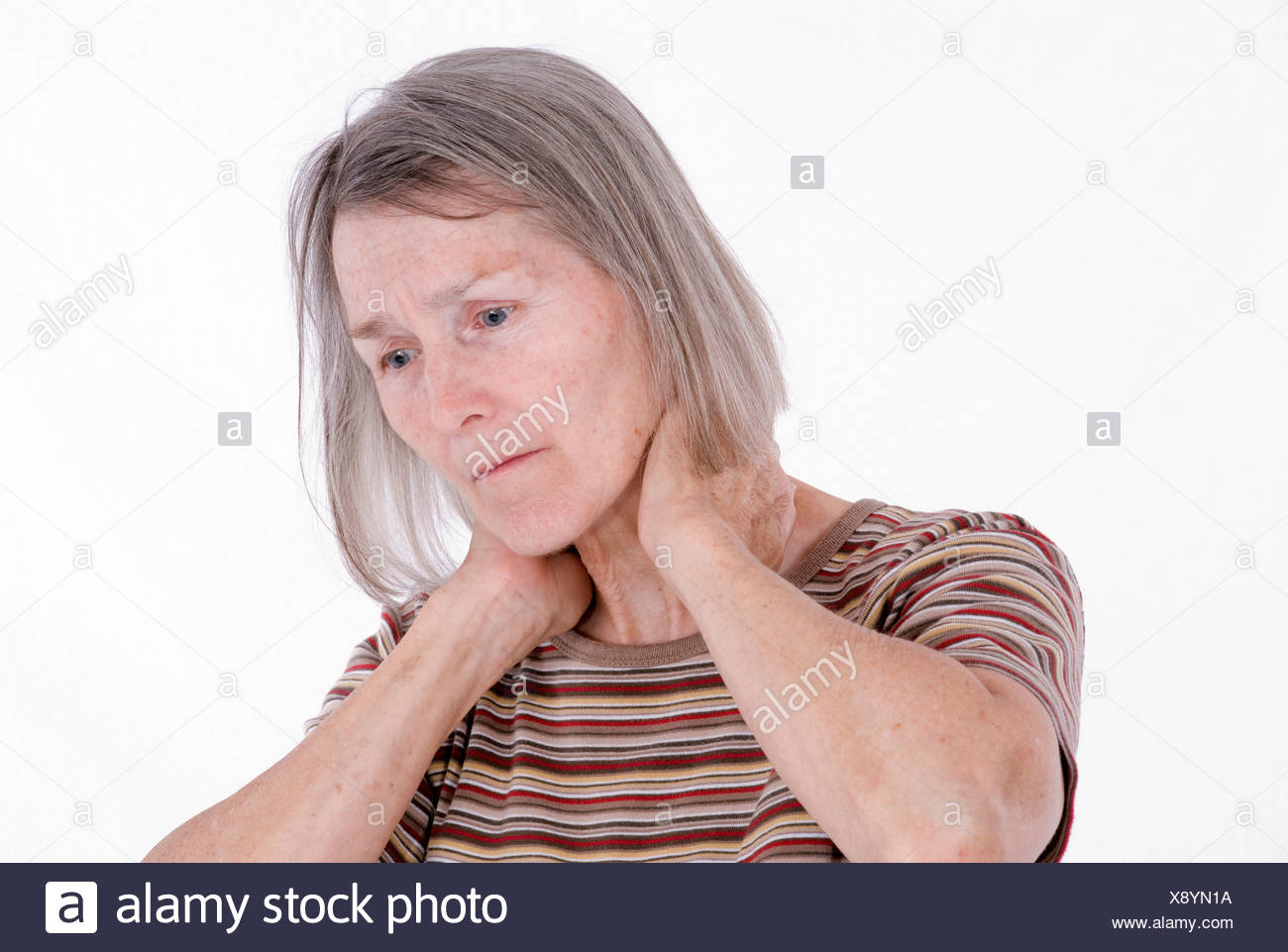 eldely woman with pain in the neck - Stock Image