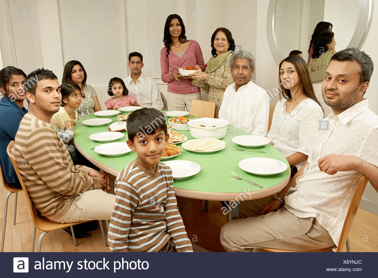 Large Family At Dining Table   Stock Image