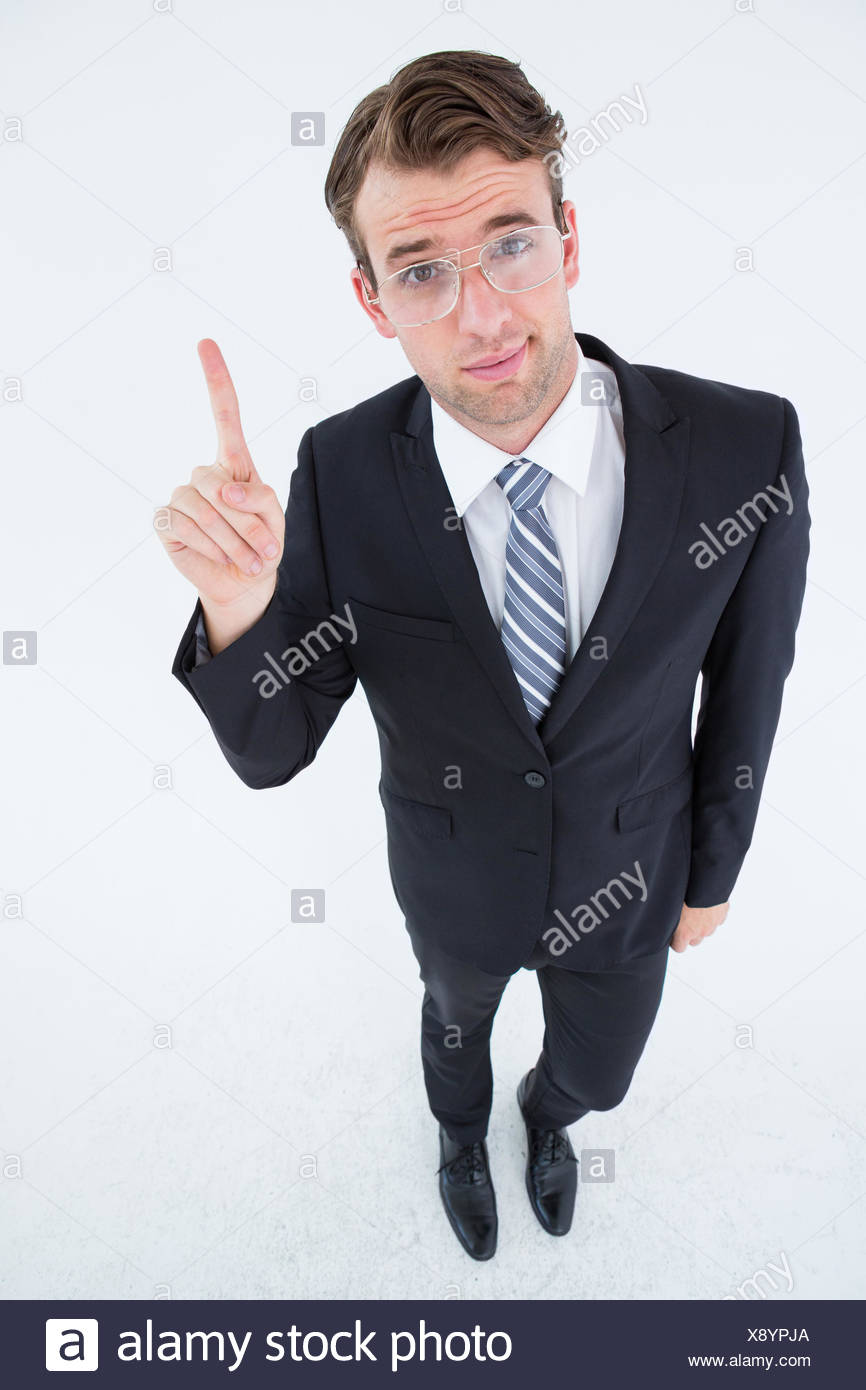 Geeky businessman with finger up - Stock Image