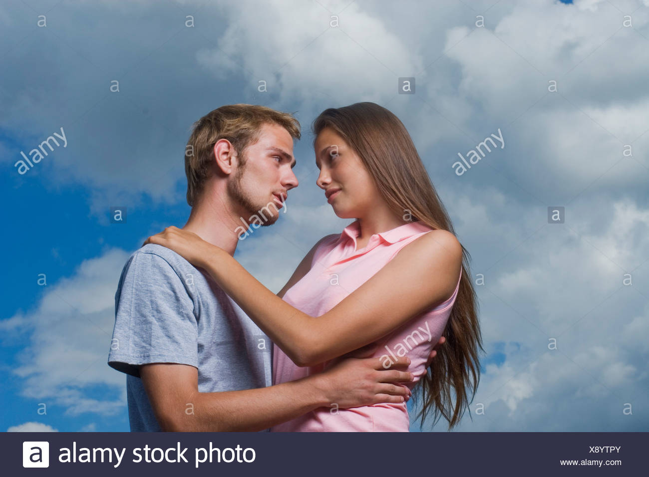 portriat of young couple tenderly looking at each other - Stock Image