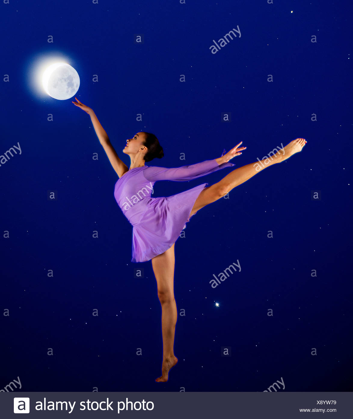 Ballerina reaching for the moon - Stock Image