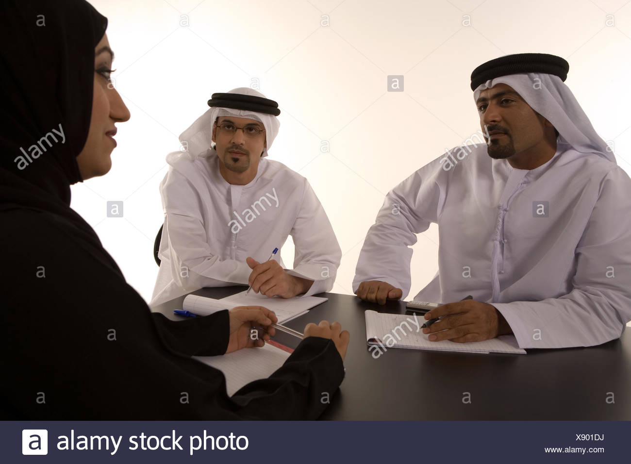 Business people in a meeting. - Stock Image