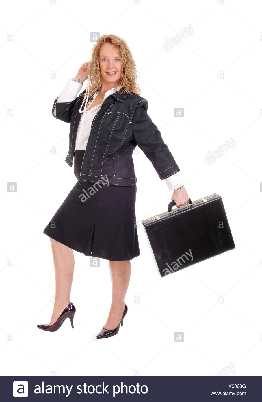 Business woman walking with briefcase. - Stock Image