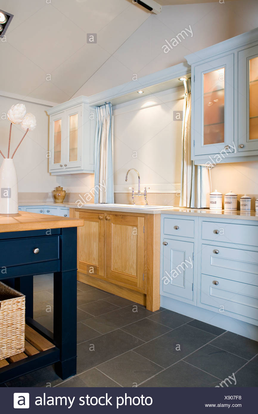 Delicieux Pale Blue Fitted Units And Limestone Flooring In Modern ...