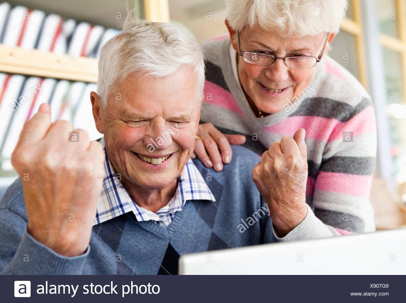 Elderly couple succeeding - Stock Image