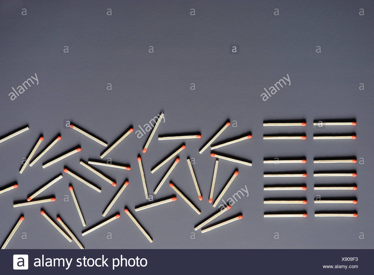Matches lined up and scattered on a surface - Stock Image