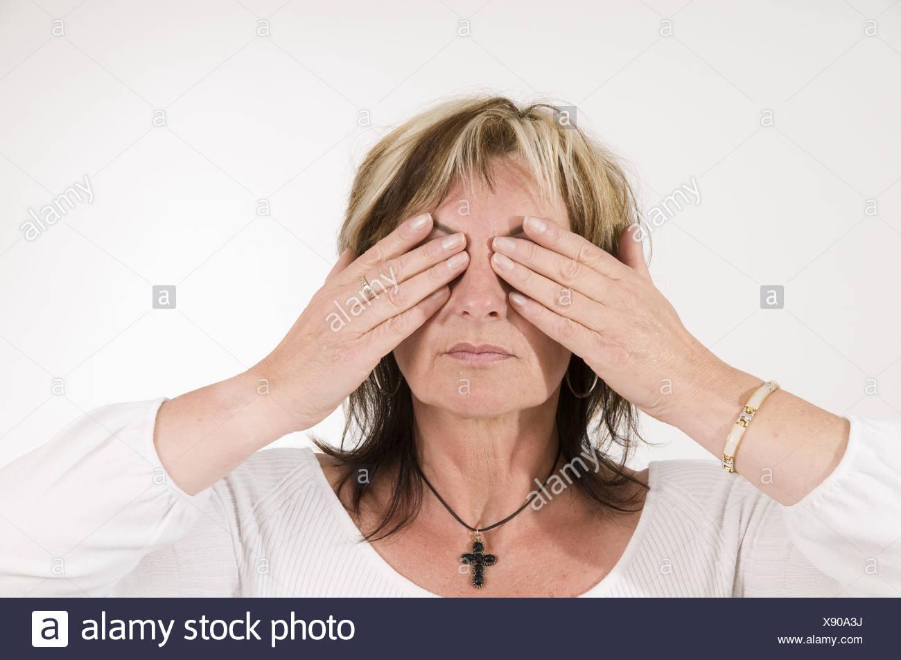 mature woman closed eyes Stock Photo