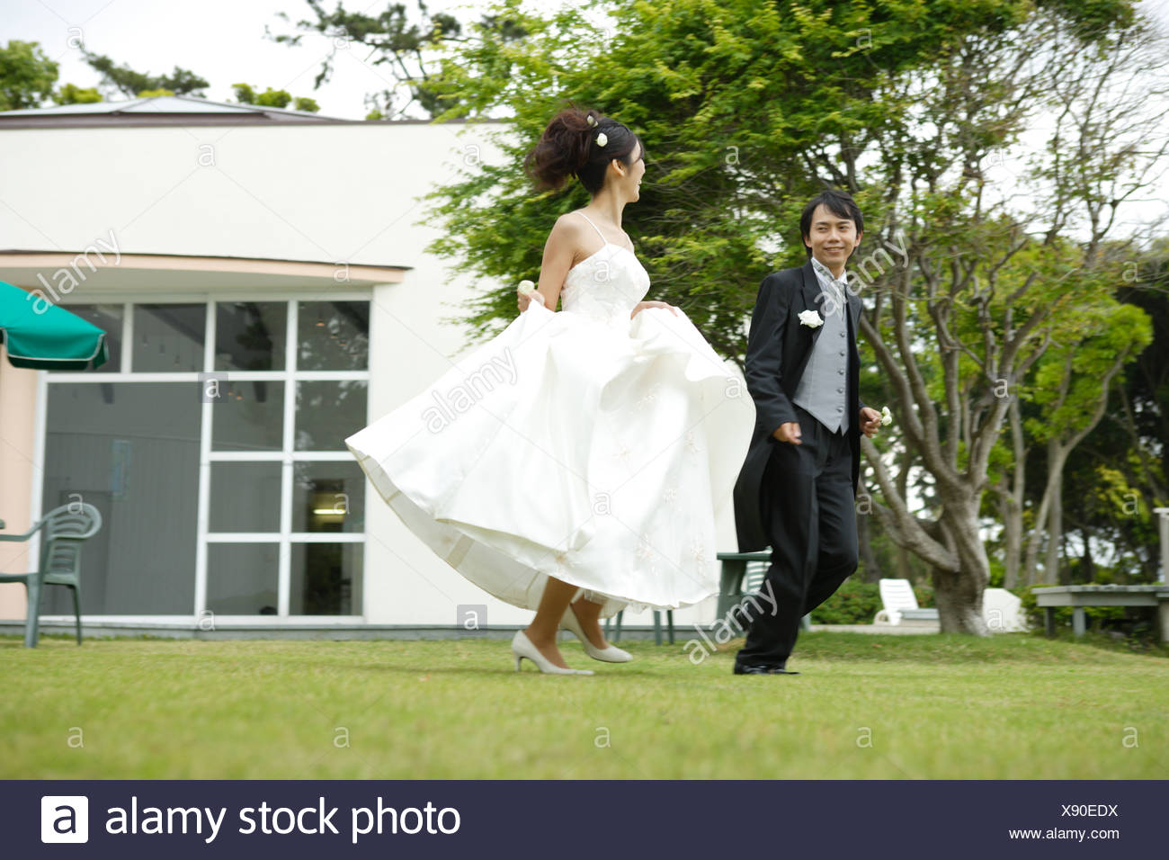 Fantastic Bride And Groom Running On Lawn Stock Photo 280909158 Alamy Download Free Architecture Designs Scobabritishbridgeorg