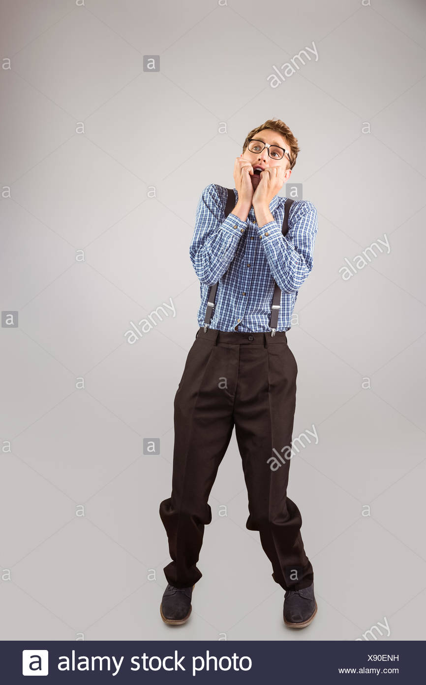 Geeky hipster biting his nails - Stock Image