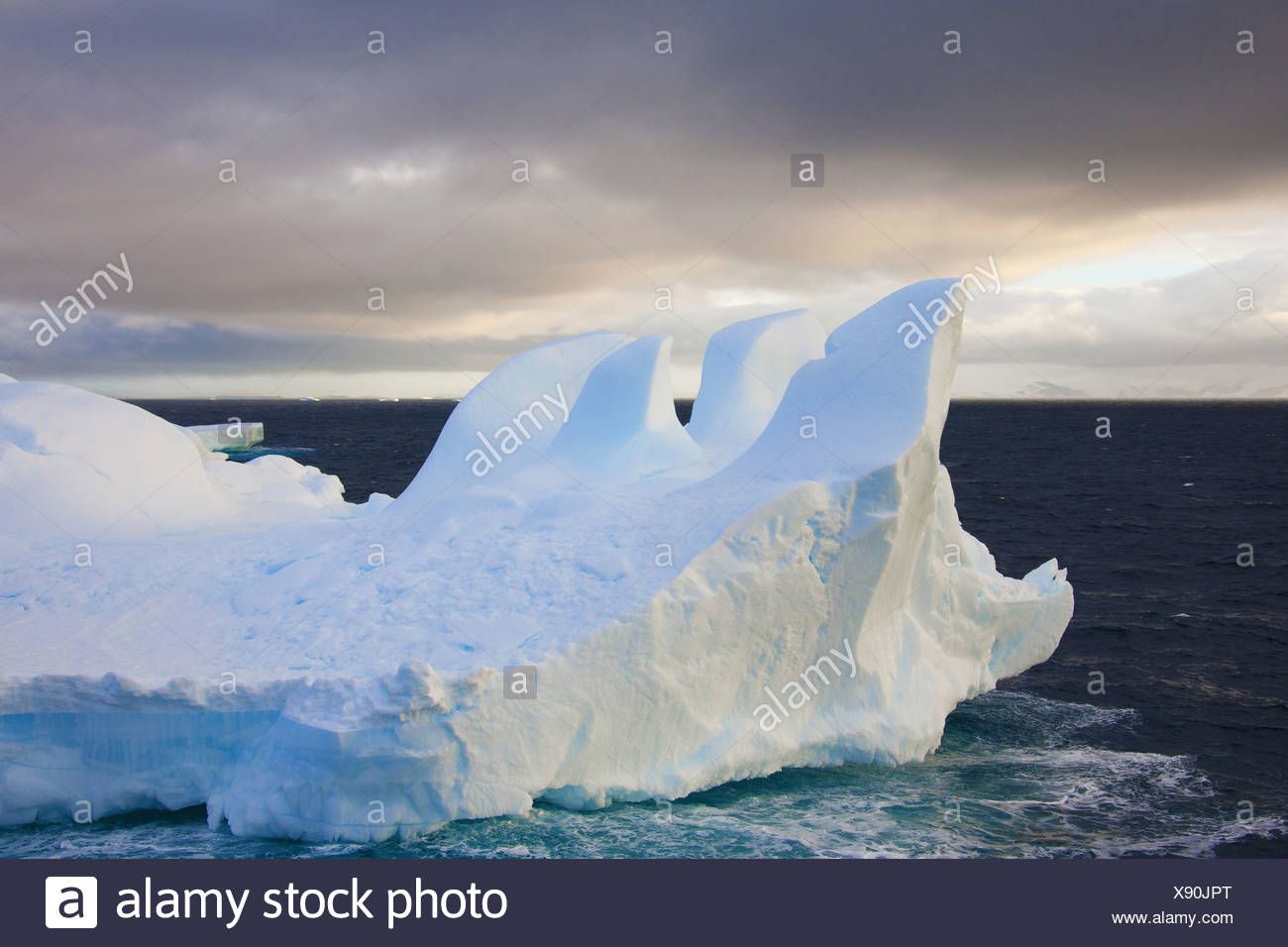 Icebergs floating on the Antarctic southern oceans Eroded by wind and weather creating interesting shapes - Stock Image