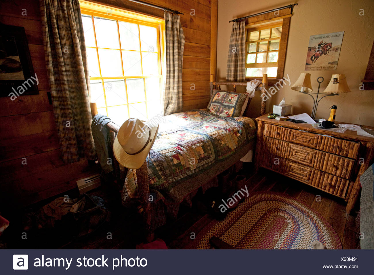 Cowgirls room in log cabin lodge on ranch in Montana, USA - Stock Image
