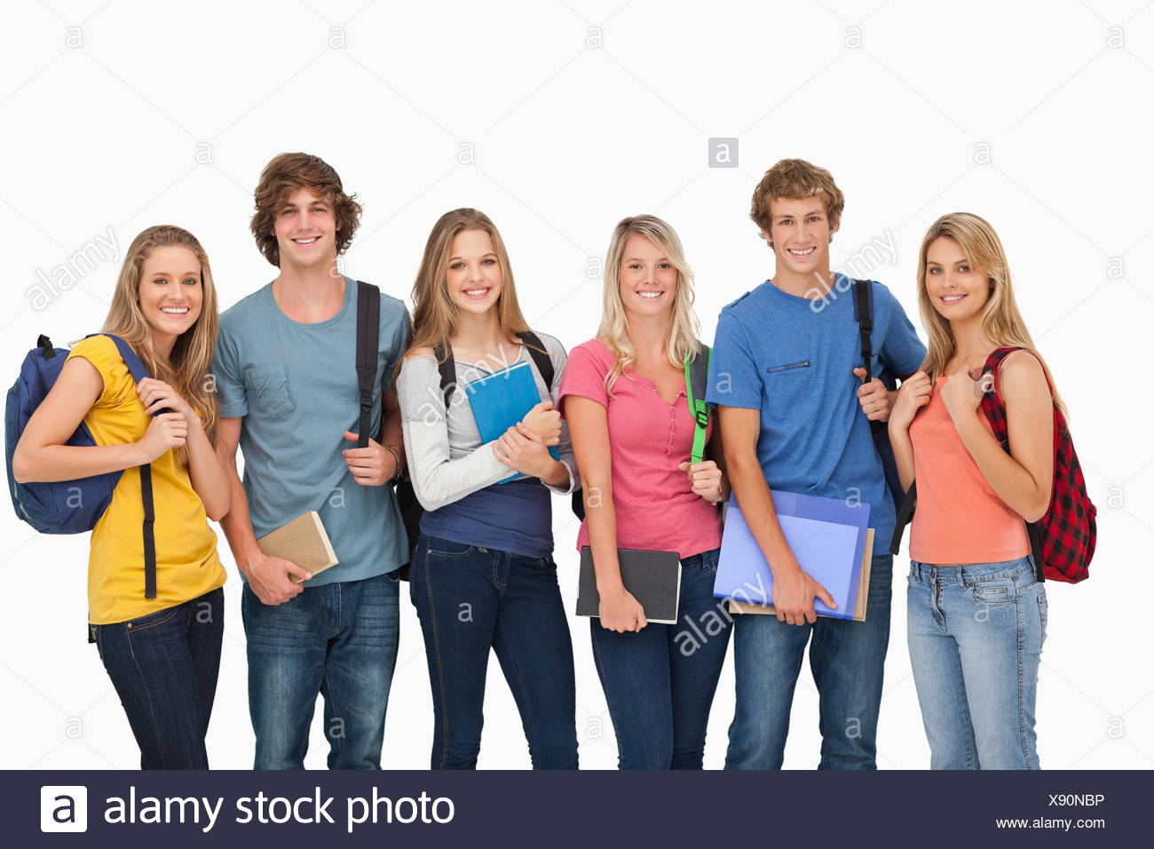 Smiling students all geared up for college - Stock Image